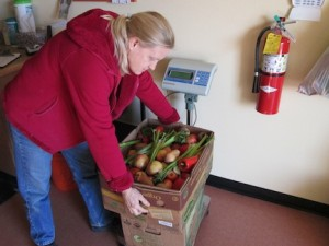Weighing gleaned produce before sorting it